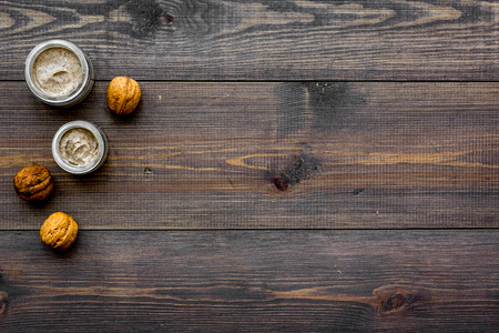 Homemade spa with organic scrub and walnut on wooden background top view space for text Stock Photo