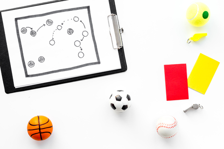 Sport judging concept. Basketball referee. Tactic plan for game, football ball, red and yellow cards, whistle on white background top view, Stock Photo