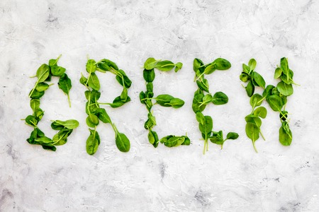 Green copy for greeny smoothy composition with vegetables on stone background top view mockup.