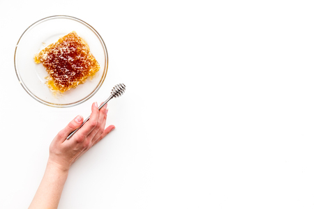 Honeycomb on plate on white background top view. Banco de Imagens