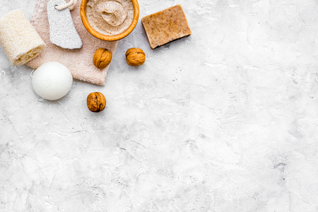 Homemade spa with organic scrub and walnut on stone background top view space for text. Stock Photo