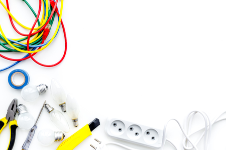 Electrical installation, wiring works. Tools, cabel and socket outlet on white background top view copy space