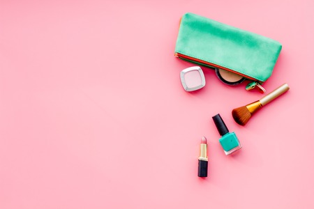 Women desk with decorative cosmetics for make up on pink background flat lay space for text Stock Photo