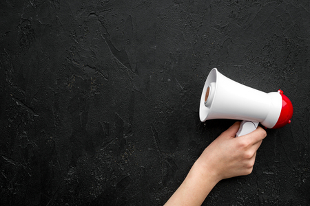 Megaphone make an announcement on black background top view copy space Stok Fotoğraf