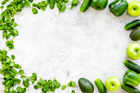 Cucumber, pepper, apple, celeriac. Vegetables for greeny organic smoothy for sport diet on stone table background top view mockup