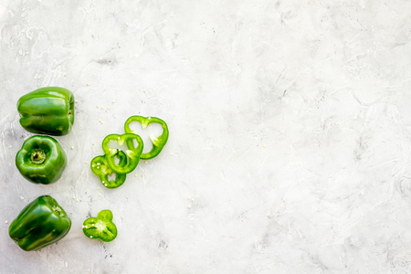Greeny cocktail ingredients. Fitness smoothie. Pepper on stone background top view space for text. Stock Photo