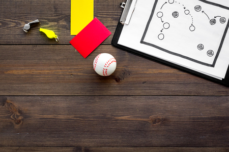 Sport judging concept. Baseball referee. Tactic plan for game, base-ball ball, red and yellow cards, whistle on wooden background top view, Stock Photo