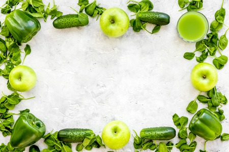 Greeny vegetable smoothie in glass on with cucumber, pepper, apple, celeriac stone table background top view mock up Stock Photo