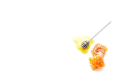 Fresh honeycomb and honey dipper on white backgroun top view copy space