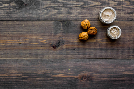 Beauty set with natural walnut scrub for spa on wooden background top view mockup