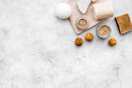 organic scrub with walnut for homemade spa on stone background top view mockup