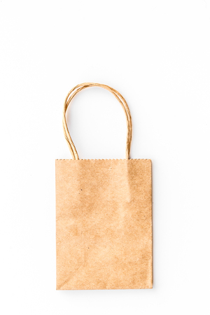 Brown kraft paper bag for shopping on white background top view. 版權商用圖片 - 98763220
