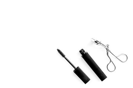 Basic products for eyelashes makeup. Mascara and eyelash curler on white background top view. 스톡 콘텐츠