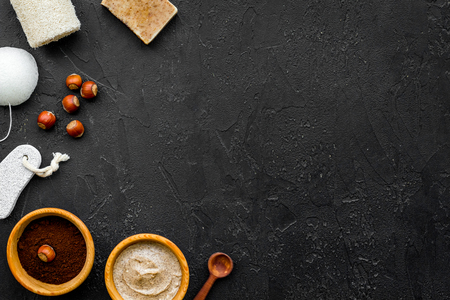 organic scrub with hazelnut for homemade spa on black table background top view mockup Stock Photo