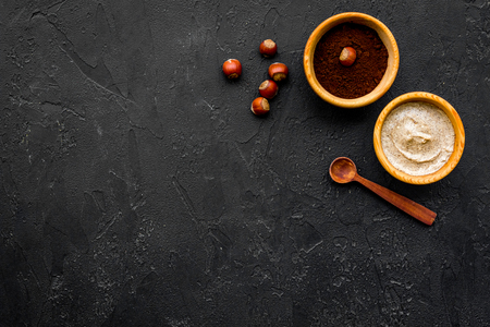 Beauty set with natural hazelnut scrub for spa on black background top view mockup Stock Photo