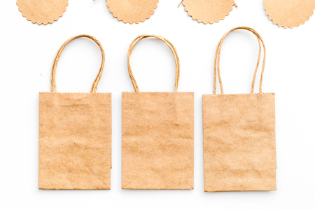 Brown kraft paper bag for shopping near price tags on white background top view mockup Stock fotó