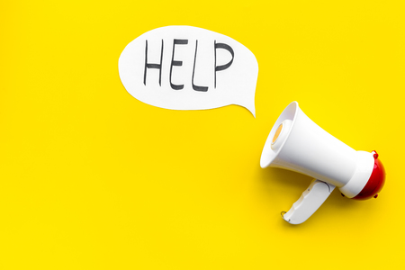 Call for help concept. Megaphone near cloud with word help on yellow background top view space for text