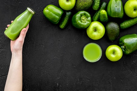 Cucumber, pepper, apple, celeriac. Vegetables for greeny organic smoothy for sport diet on dark background top view mockup