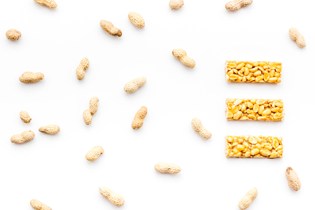 Energy protein snacks with peanuts on white background top view