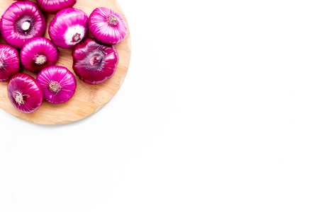 Red onion for salads on white background top view copy space