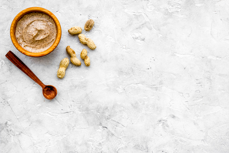Treatment set with natural peanut scrub to take bath on stone background top view mock-up Stock Photo