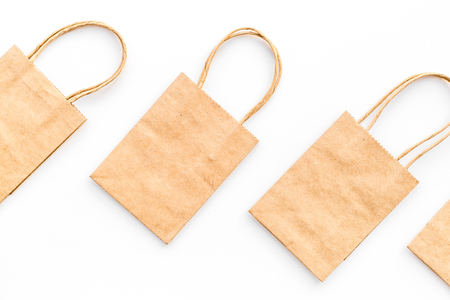 Brown kraft paper bag for shopping on white background top view mockup