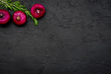 Red onion for salads on black background top view copy space Stock Photo