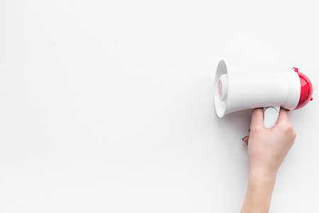 Attract attention concept. Megaphone in hand top view copy space Stok Fotoğraf