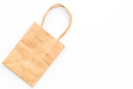 Brown kraft paper bag for shopping on white background top view. 版權商用圖片 - 99122913