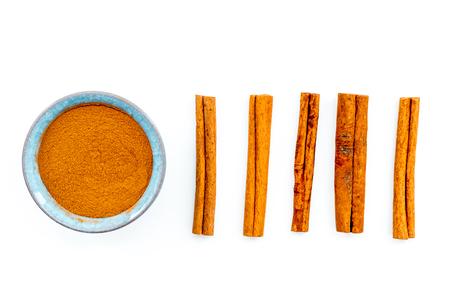 Cinnamon seasoning. Sticks and powder on white background top view.