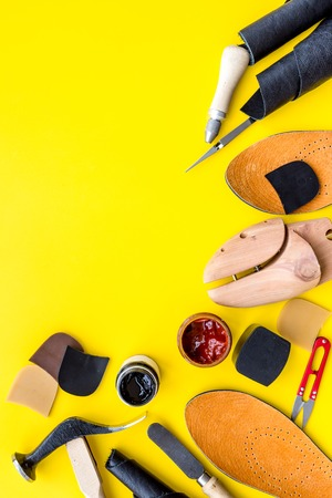 Clobber tools on yellow background top view.