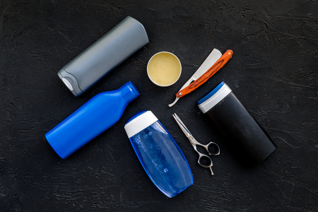 Mens bathroom set. Cosmetics for bath, tools for brushing and grooming on black background top view.