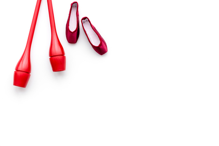 Beauty sport for girls concept. Maces for rhythmic gymnastics and ballet shoes on white background top view. Stock Photo - 99261980