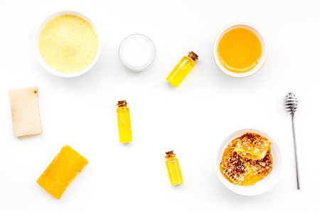 Honey as product for body, face and hair care. Cosmetics with honey. White background top view.
