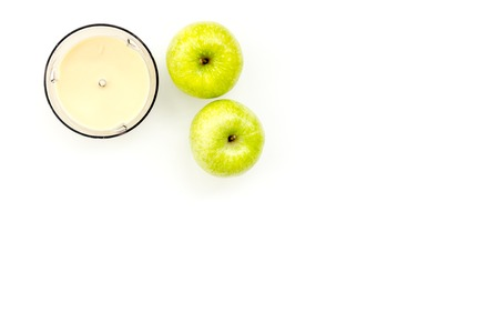 Healthy food for little baby. Apple puree with on white background top view copy space