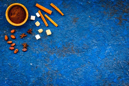 Flavoring products for making desserts. Cinnamon, cocoa, coffee on blue table top view space for text Stock Photo