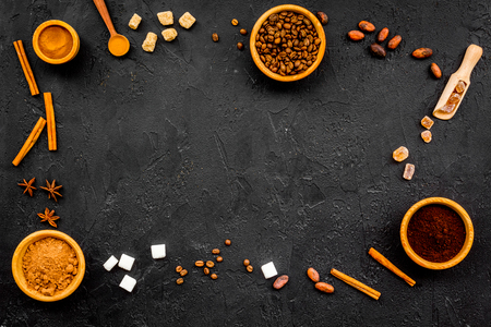Seasoning for cooking desserts. Cinnamon, cocoa, badian on black background top view space for text