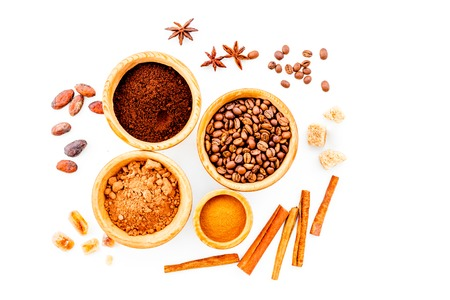 Seasoning for cooking desserts. Cinnamon, cocoa, badian, coffee, sugar on white background top view