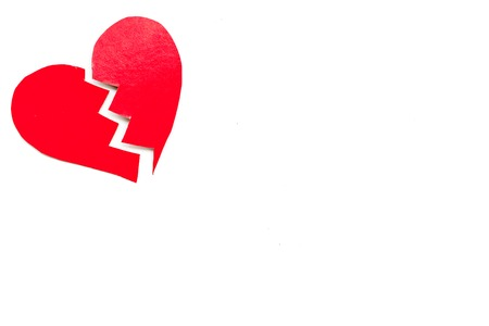 Divorce concept. Broken paper heart on white background top view.