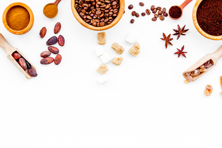 Seasoning for cooking desserts. Cinnamon, cocoa, badian, coffee on white background top view.