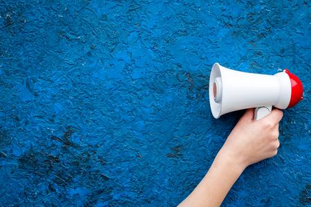 Announcement concept. Megaphone in hand top view copy space Stok Fotoğraf
