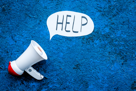 Call for help concept. Megaphone near cloud with word help on blue background top view. Archivio Fotografico - 99601383