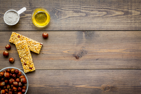 Energy protein snacks with nuts on wooden background top view.