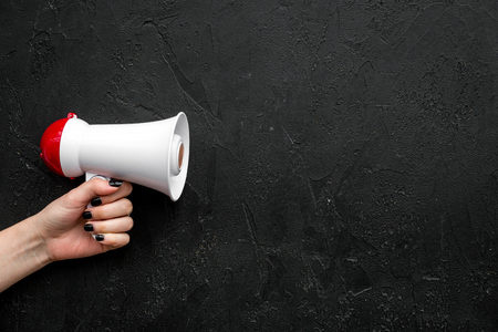 Announcement concept. Megaphone in hand on black background top view copy space Stok Fotoğraf
