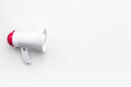 Attract attention concept. Megaphone on white background top view copy space 스톡 콘텐츠