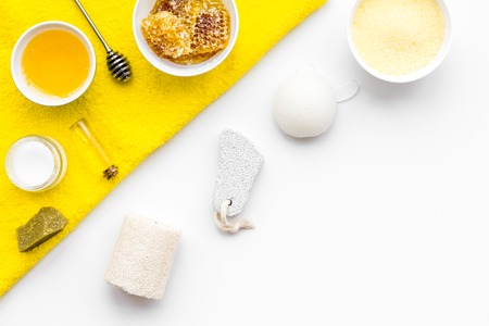 Honey spa set with natural honey, soap, cream, towel and pumice stone on white background top view. Stock Photo