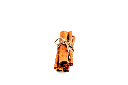 Cinnamon sticks on white background top view copy space. Condiment for mulled wine Standard-Bild