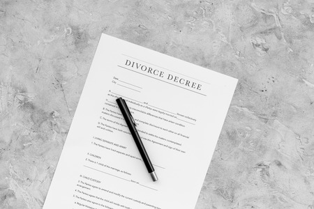 Divorce decree. Document on grey background top view copy space Stock Photo