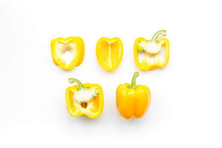 Layout of yellow sweet bell pepper slices on white background top view pattern