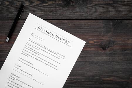 Divorce decree. Document on dark wooden backgroud top view